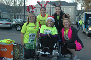 Guides Cassie Mcdonald, Jenna Schuchard, Tiffany Turner, and Becky Richardson dressed up as reindeer and Athlete Amy Saffell dressed up as Santa