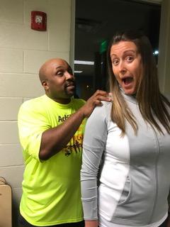 Athlete Chris Pennington giving Guide Carrie Redmon a shoulder massage