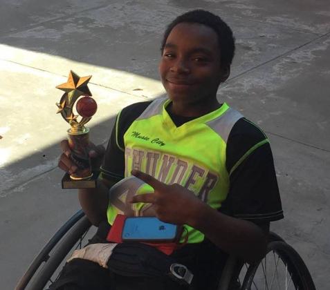 Jrod holding his medal
