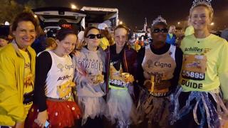 Group shot of Disney half marathon (Ginger on far right)