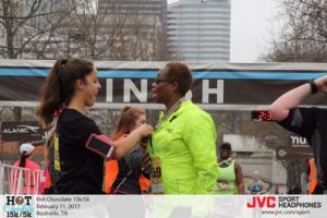 Theresa Khayyam getting a medal at the hot chocolate 15K