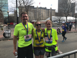 Guide Harvey Freedman (on left), Athlete Stephanie Zundel (in the middle), Guide Amy Harris (on right